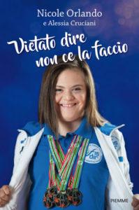 foto di Nicole con uniforme sportiva e medaglie al collo