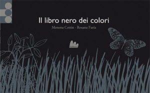 Libro con copertina nera e grigia con disegno di erba e farfalla